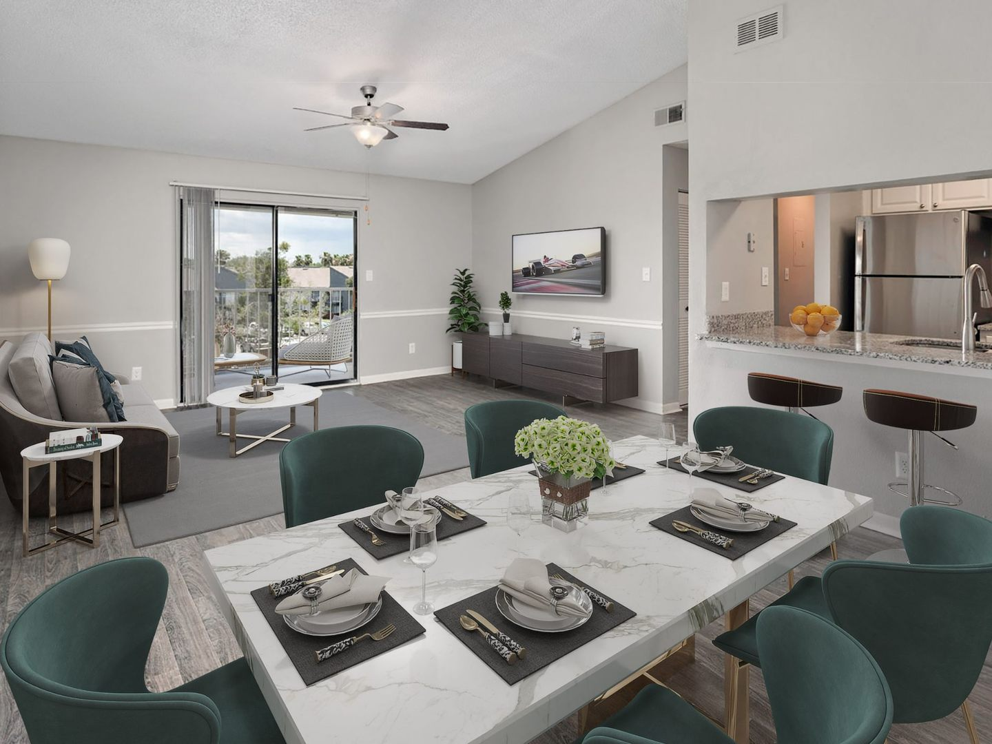 Apartment dining area with view of living area