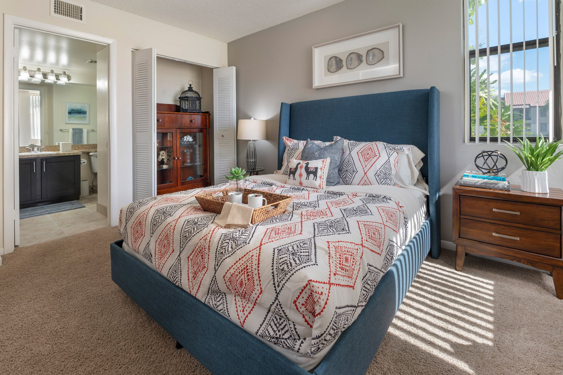 Large bed in airy apartment bedroom