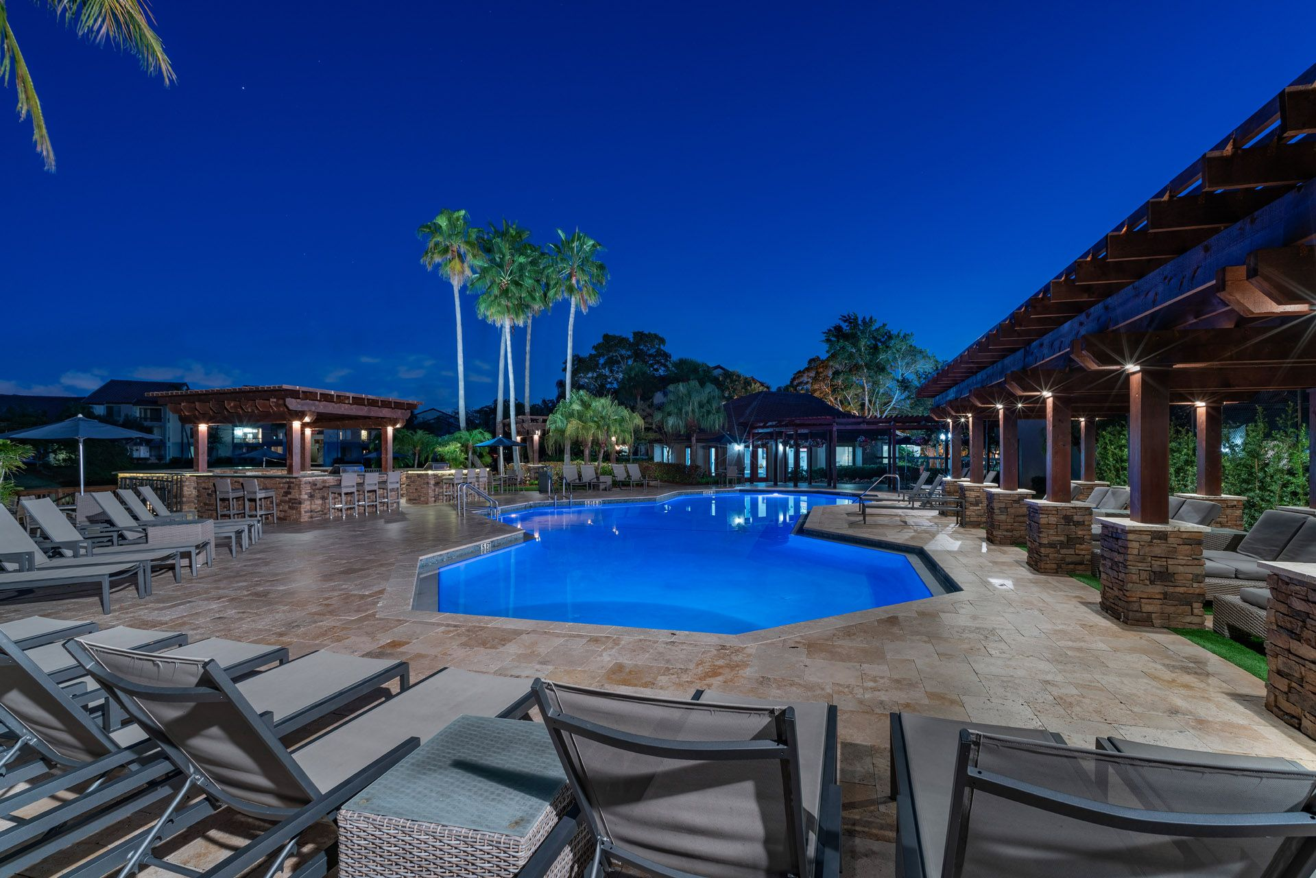 Swimming pool at night with seating