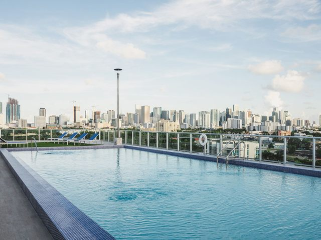 Rooftop pool with a view of the city skyline.