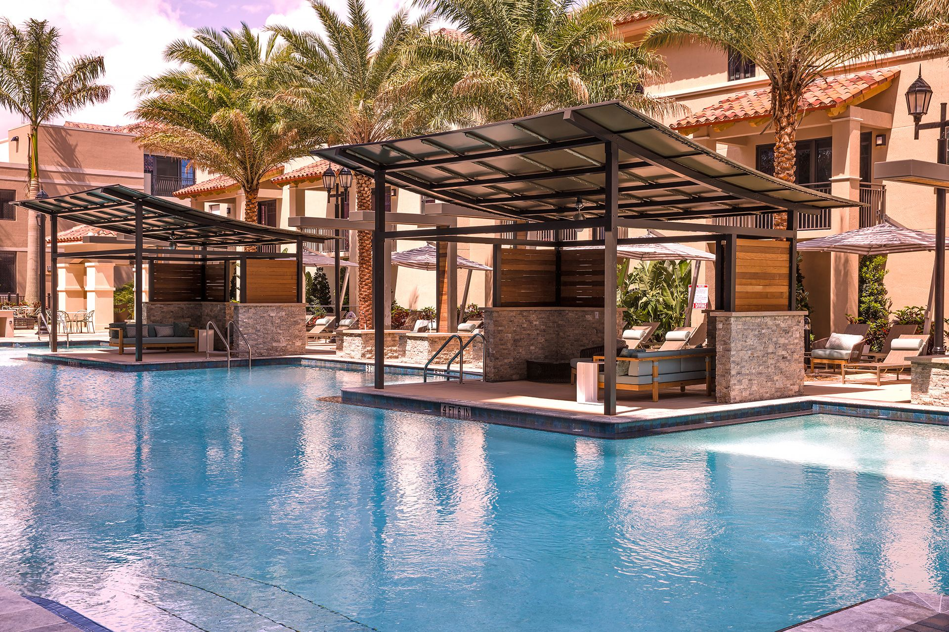 Poolside cabanas with seating