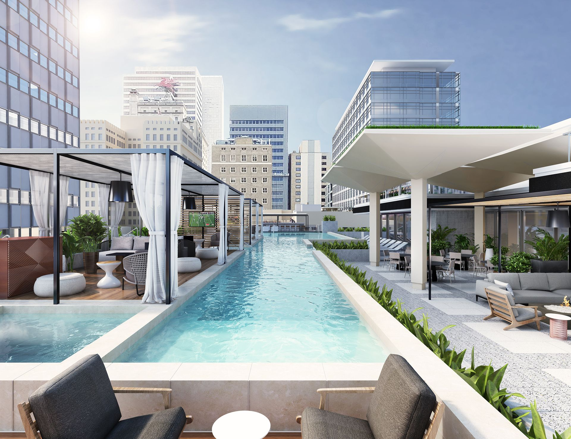 Rooftop pool with view of downtown skyline