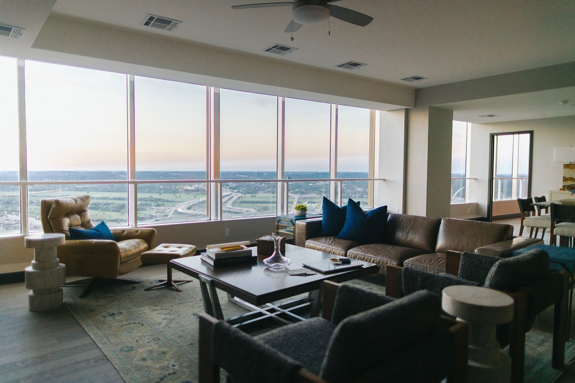 Apartment living area with seating and view of city