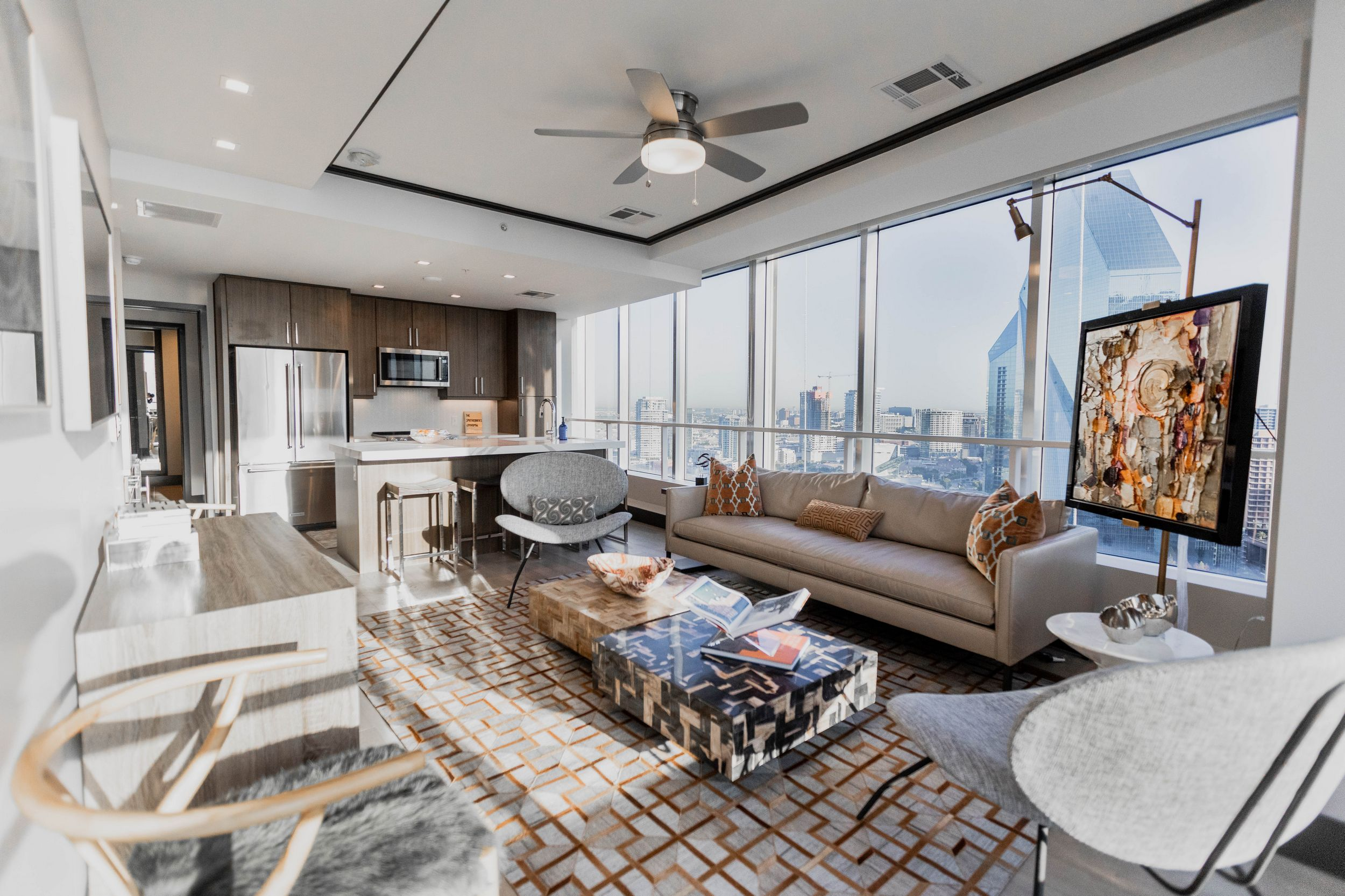 apartment living room and kitchen with floor-to-ceiling windows