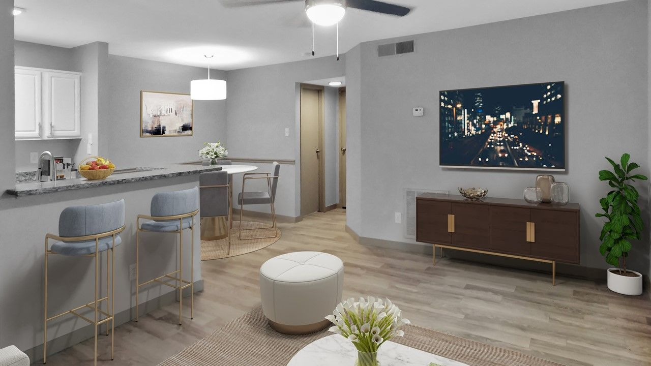 Apartment living and kitchen area with bar and seating