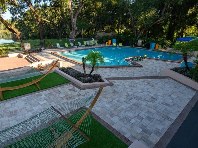 Swimming pool with seating and hammock area