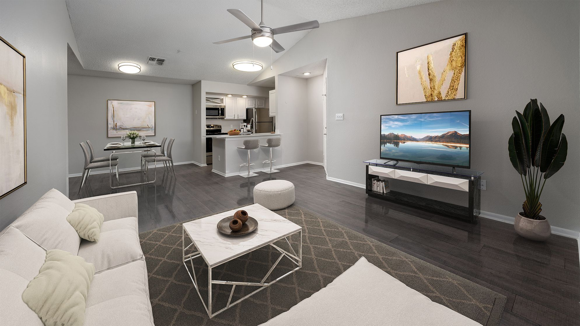 Apartment living area with seating and view of kitchen