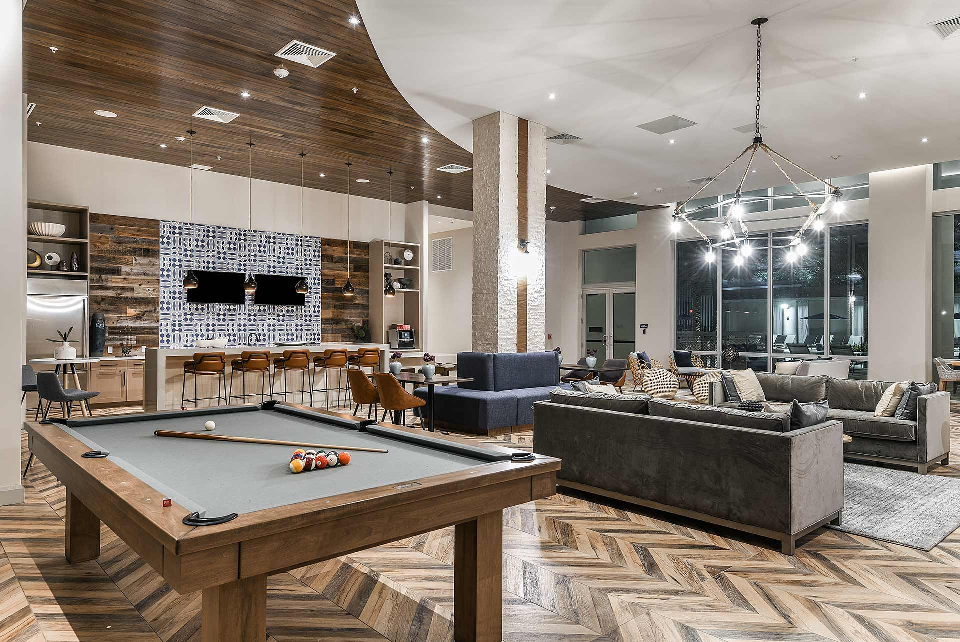 Clubhouse with seating and pool table