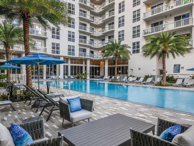 swimming pool and lounge deck with comfortable lounge seating.