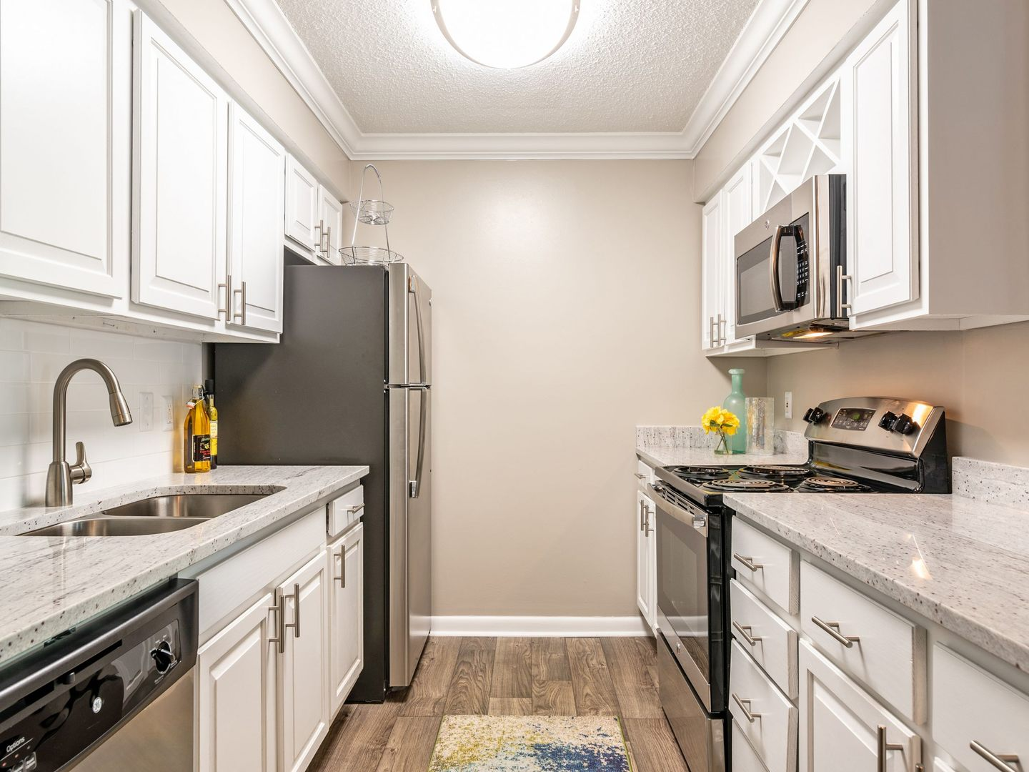 kitchen with granite countertops and white cabinetry.