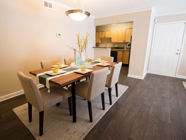 Apartment dining room with a table and six chairs