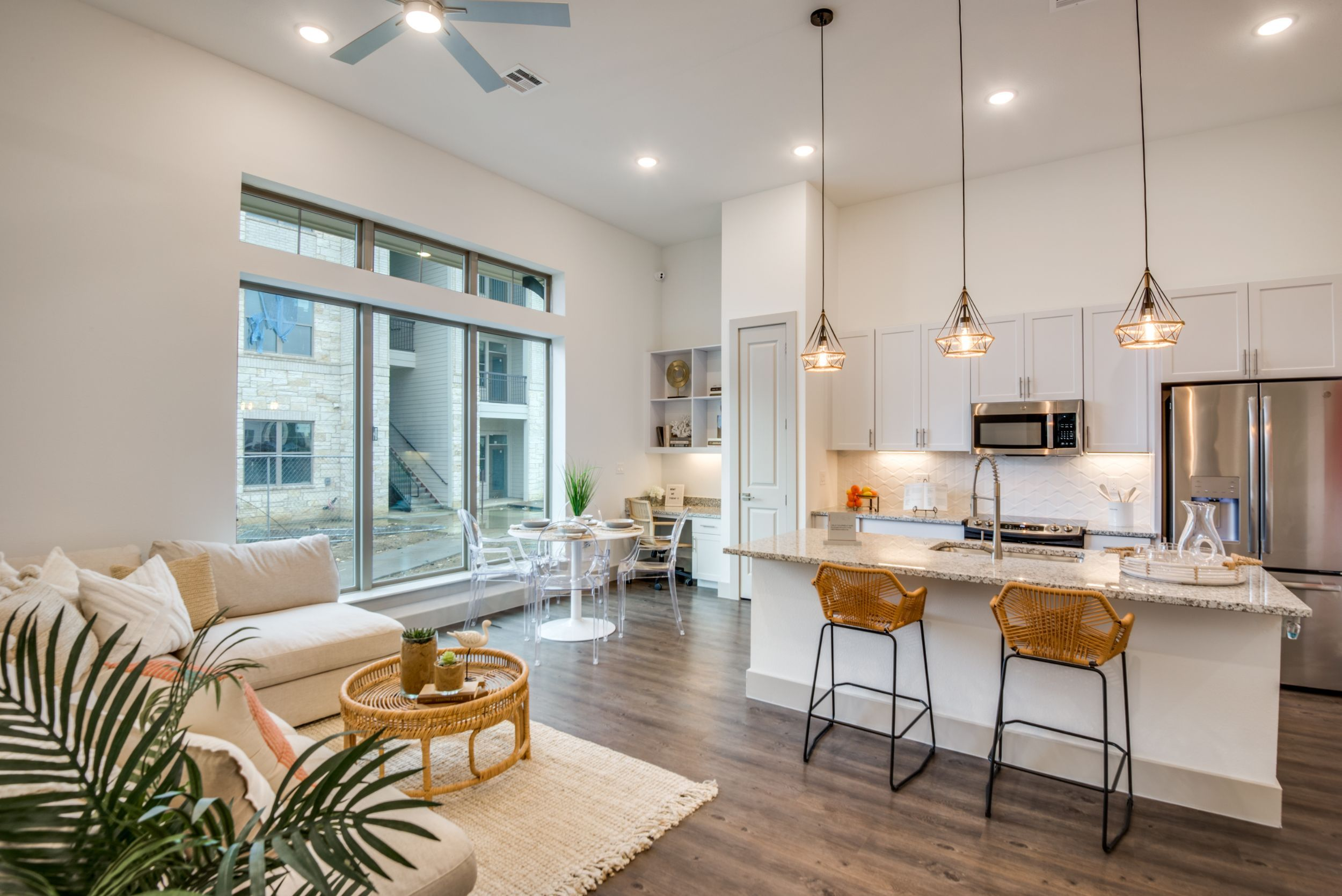 Apartment living and kitchen area with seating and bar