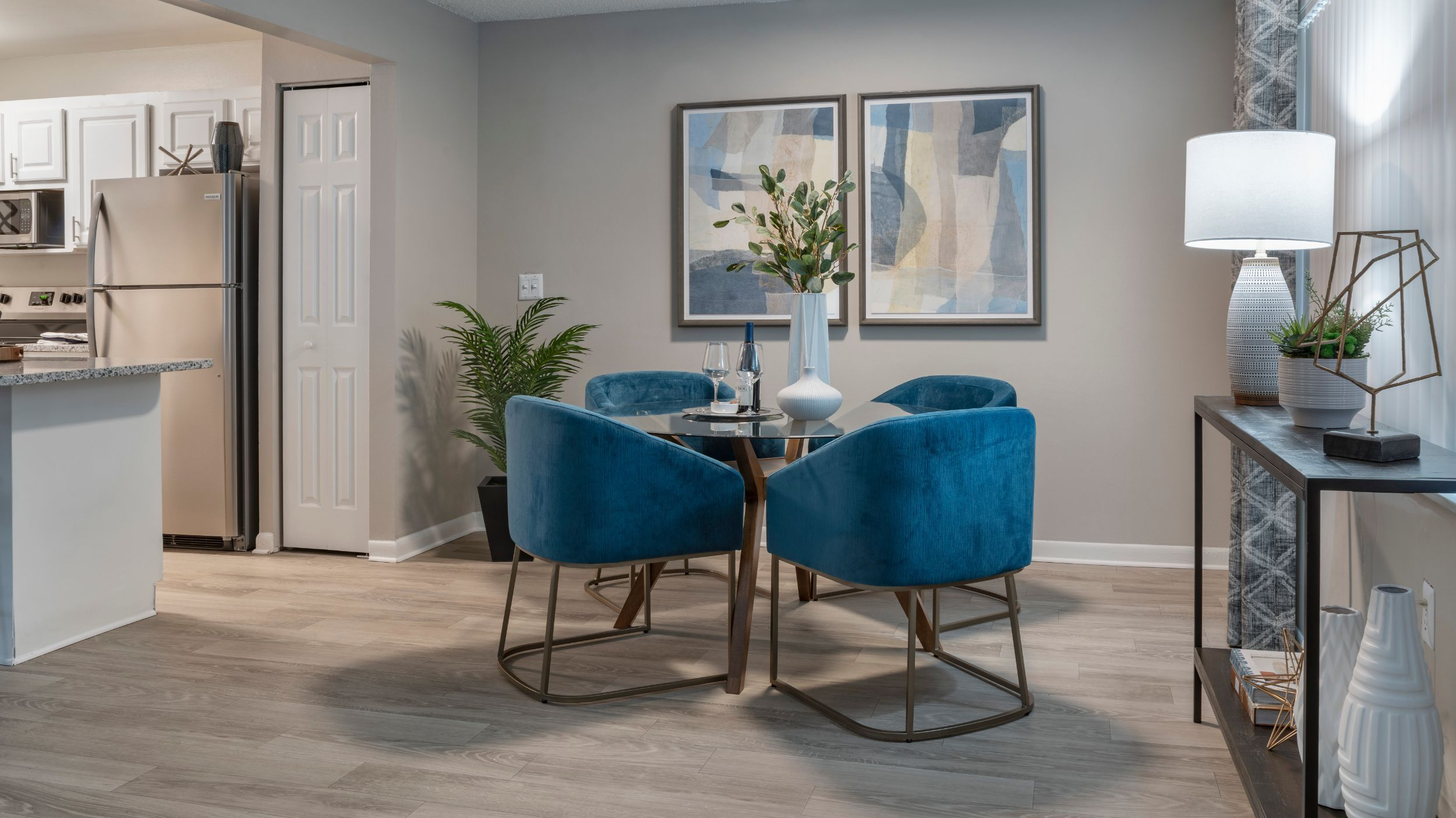 Apartment dining area with blue chairs and table
