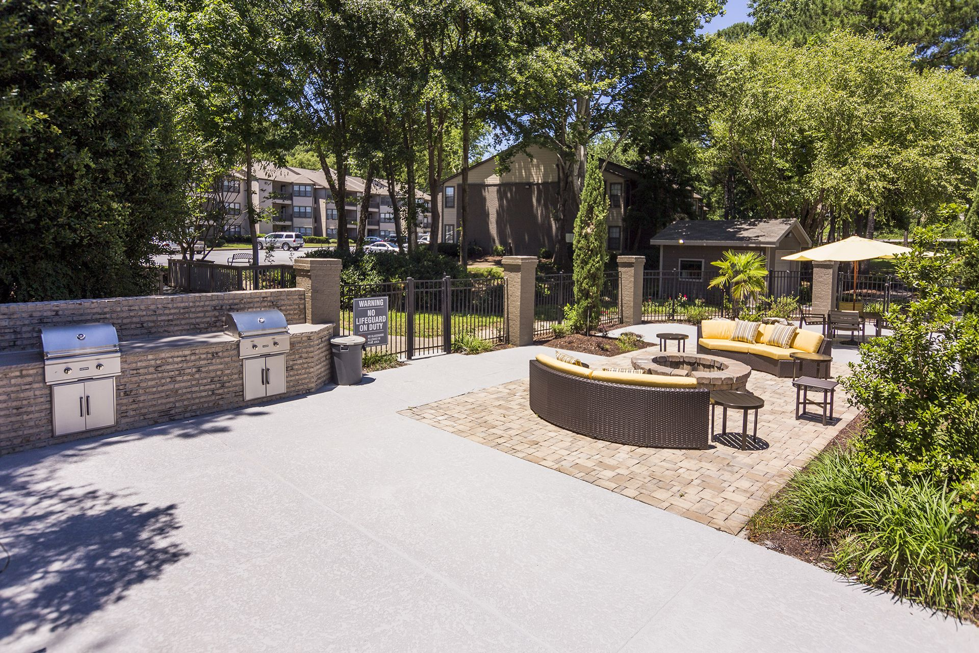Outdoor grilling area with seating and fire pit