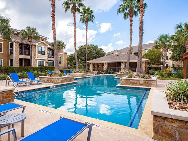 Resort style pool with blue loungers